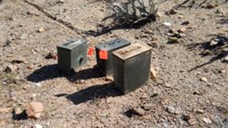 Some of the seven cans of ammunition containing explosive devices recovered by deputies. (Source: MCSO)