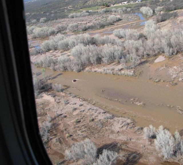An elderly couple seen from the air has the pilot and crew of a DPS helicopter to thank for rescuing them from a swollen creek Sunday. (Source: Arizona Department of Public Safety)