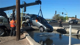 Vehicle pulled out of canal. (Source: Sergio Hernandez, cbs5az.com)