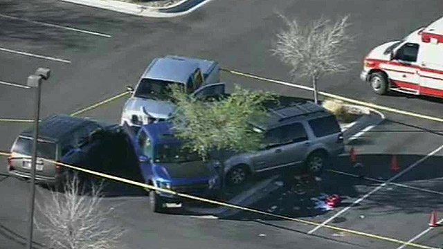 DPS officers shot and wounded a vehicle theft suspect in this parking lot in San Tan Valley on Thursday morning. (Source: CBS 5 News)