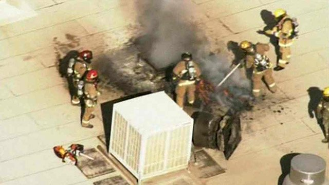 Phoenix firefighters take on a rooftop fire at a FedEx freight warehouse Monday morning. (Source: CBS 5 News)