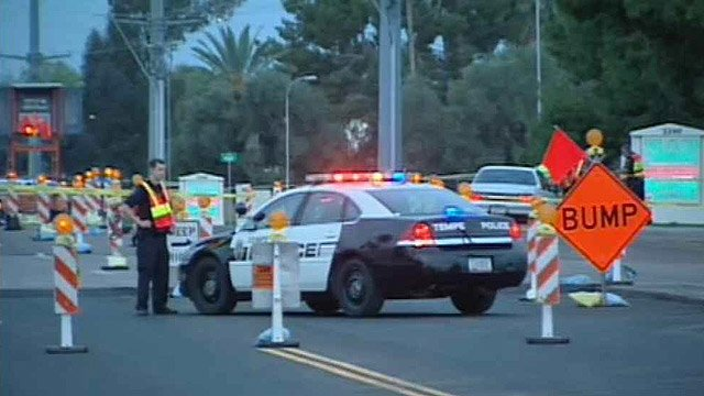 A pedestrian was badly hurt after being hit by a car mid-block on University Drive on Wednesday morning. (CBS 5 News)