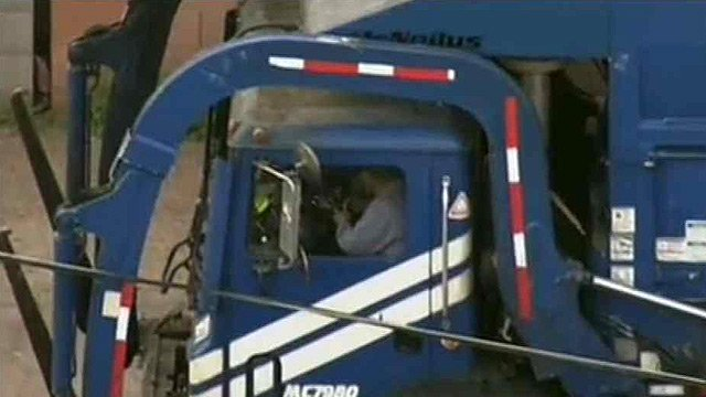 Live wires trap a Republic Services garbage truck driver in his cab. (Source: CBS 5 News)