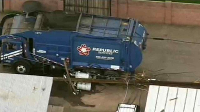 The wires draped over the truck after the truck hit a power pole in a Phoenix alley. (Source: CBS 5 News)