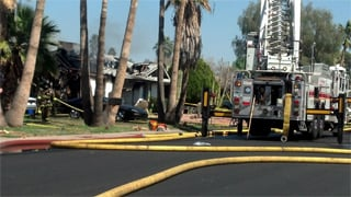 Mesa house fire.  (Source: Christina Batson, cbs5az.com)