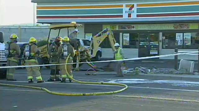 Crews dig in an area where they suspect a natural gas leak occurred Monday morning. (Source: CBS 5 News)