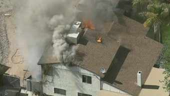Fire devours a Phoenix home near 43rd Avenue and Union Hills. (Source: KPHO-TV)