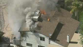 Fire devours a Phoenix home near 43rd Avenue and Union Hills. (Source: KPHO-TV)