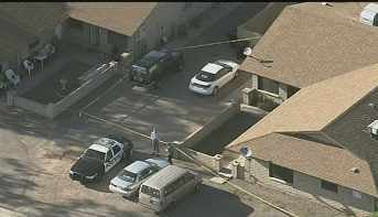 Police scene in the 4500 block of East Caballero Circle in Mesa. (Source: KPHO-TV)