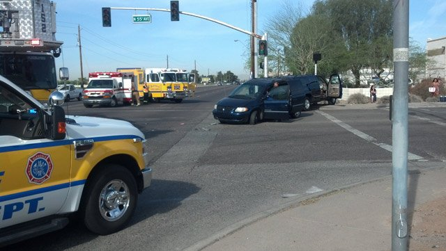 Three children were slightly injured when a large SUV and minivan were involved in a T-bone crash in Glendale on Thursday morning. (Source: CBS 5 News)