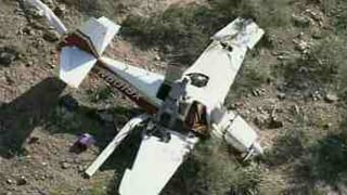 The plane was a single-engine Mooney M20. (Source: KPHO-TV)