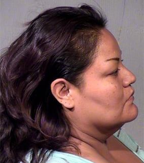 Upshaw was arrested on suspicion of child abuse and hindering prosecution. (Source: Maricopa County Sheriff's Office)