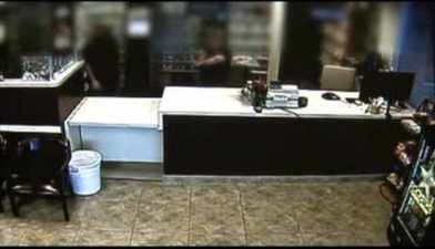 Surveillance image of one of the 3 armed robberies (Source: Phoenix Police Dept.)