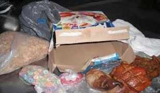 (Source: U.S. Customs and Border Protection) Illegal pork products discovered in a cereal box.