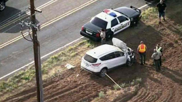 The driver of this SUV is believed to have been impaired when she slammed into the back of a PInal County school bus Thursday morning, according to a sheriff's office spokeswoman. (Source: CBS 5 News)