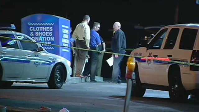 Phoenix police and DPS officers investigate the scene of an officer-involved shooting in the parking lot of a Chevron station near 35th Avenue and Camelback Road on Sunday night. (Source: CBS 5 News)