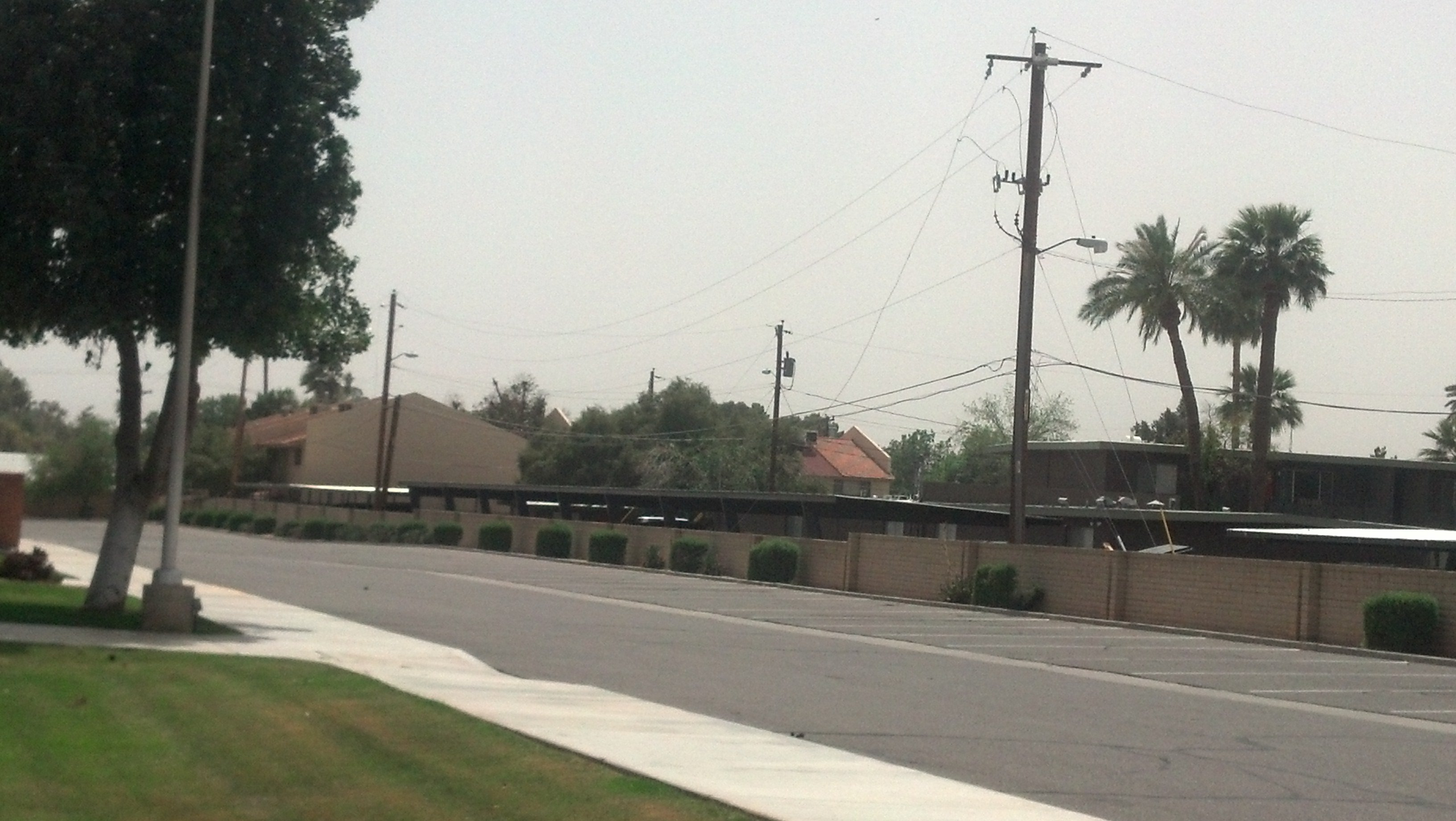 Winds knocked down power lines on 18th Street Monday afternoon. (Source: CBS 5 News, Christina Batson)