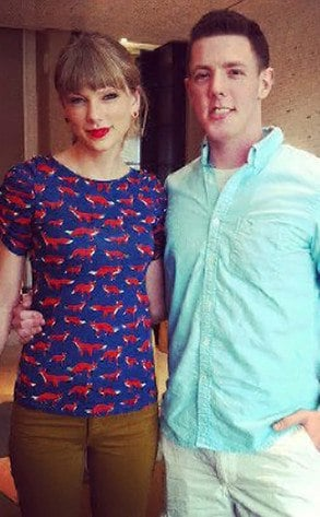 Taylor Swift posing with long-time fan Kevin McGuire (Source: Facebook)