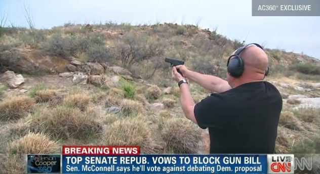 Mark Kelly, husband of Gabrielle Giffords, takes target practice at the home of his mother-in-law in Arizona. (Source: CNN)