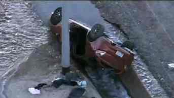 Car lands in Surprise canal. (Source: KPHO-TV)
