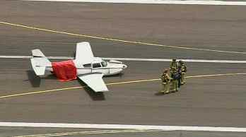 Plane lands with landing gear up. (Source: KPHO-TV)