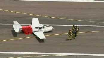 Plane lands with landing gear up. (Source: KPHO-TV)