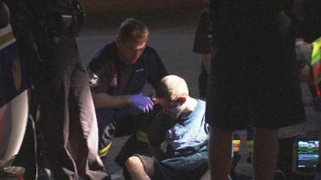 Anthony Brian Giunta, a suspect in a double homicide in Phoenix on Monday night, is treated by Phoenix firefighters. (Source: CBS 5 News)