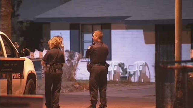 Phoenix officers at the scene of a double homicide in north Phoenix. (Source: CBS 5 News)