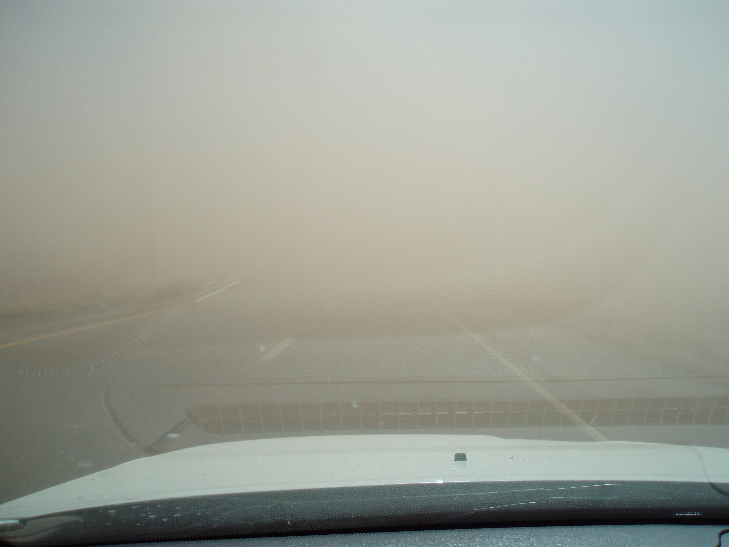 The photos show a progression of limited visibility due to blowing dusts and high winds in the area. (Source: ADOT)