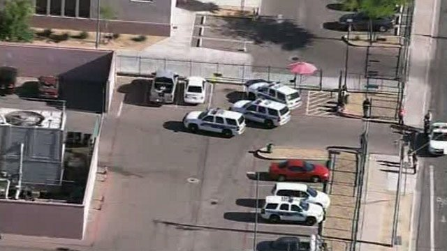 Police at North High School in Phoenix after a bomb threat was phoned in Friday morning. (Source: CBS 5 News)