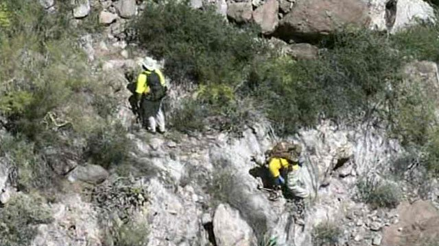 Searchers make their way to recover the body of a missing hiker found Friday. (Source: CBS 5 News)