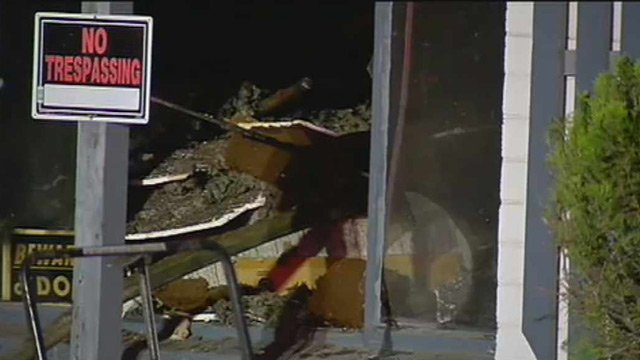 Debris and furniture was in and around the home. (Source: CBS 5 News)