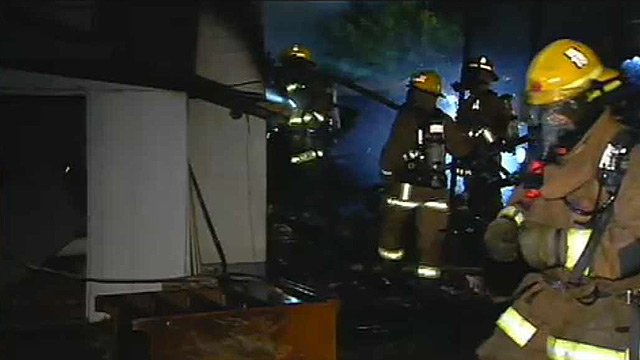 Firefighters had to climb over furniture stacked inside a house that caught fire Thursday morning. (Source: CBS 5 News)