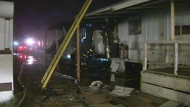 The fire caused extensive damage to the vacant mobile home. (Source: CBS 5 News)