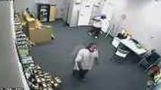 Surveillance image of the robbery in progress. (Source: Chandler Police Department)