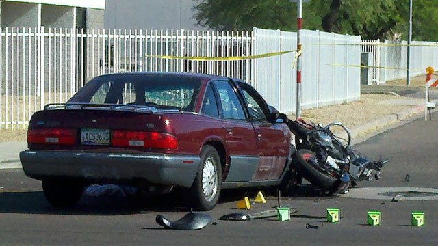 A motorcyclist was killed in a collision with car in Phoenix Thursday morning. (Source: Todd Jackson / CBS 5 News)