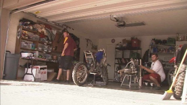 Nick Jarvis, left, and Phil Kockerbeck decided to create their own business in this Tempe garage, bucking the trend of a tough economy for recent graduates. (Source: CBS 5 News)