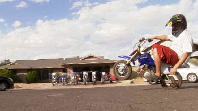Kockerbeck shows off his prowess while taking this mini-bike for a spin in the cul de sac of their Tempe neighborhood. (Source: CBS 5 News)