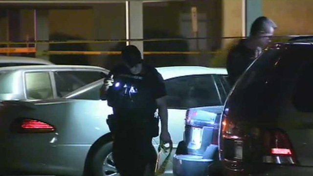 Glendale police search a parking lot near the scene of a shooting Tuesday night. (Source: CBS 5 News)
