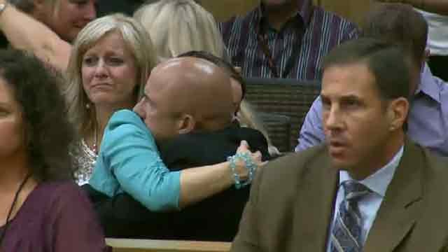 Hugs exchanged after verdict is announced. (Source: KPHO-TV)