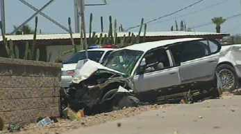 One of the cars crashed into a block wall. (Source: KPHO-TV)