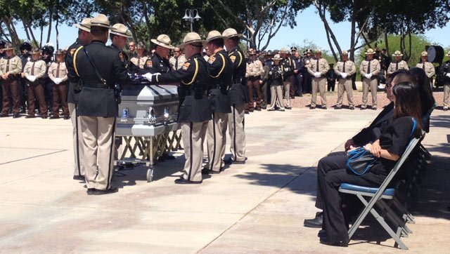DPS officers stand at the casket for fallen Officer Tim Huffman on Wednesday. (Source: KSWT-TV)