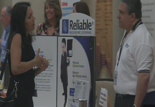 Attendee checks out one of the expo booths (CBS 5 News)