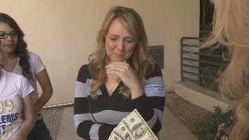 Rebecca's mother receiving the $500 Pay It Forward money from Rebecca's classmates and teacher. (Source: CBS 5 News)