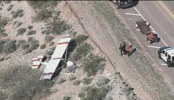 The plane went down on Old Carefree Highway in Peoria on Tuesday morning.