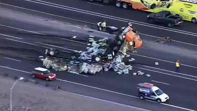 A tractor-trailer carrying a load of mulch crashed and rolled on eastbound I-10 Friday morning.
