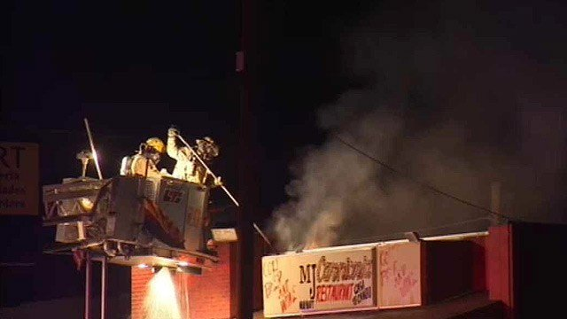 Firefighters battle a blaze at a Phoenix meat shop Thursday morning.  (Source: CBS 5 News)