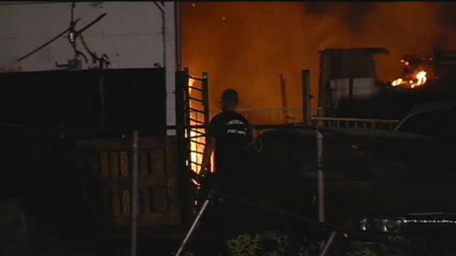 Phoenix firefighters battle a blaze in a pasture area near 64th Avenue and Van Buren Streets on Monday morning. (Source: CBS 5 News)