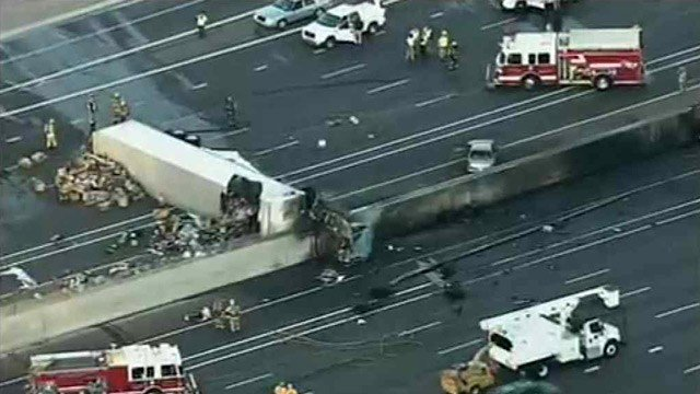 One person died in this fiery truck crash on I-10 at the Broadway Curve on Thursday. (Source: CBS 5 News)
