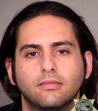Alexander Michael Herrera, 23, was a passenger on an Alaskan Airlines flight Monday morning from Alaska to Portland, OR. (Source: Multnomah County, OR, Sheriff's Office)